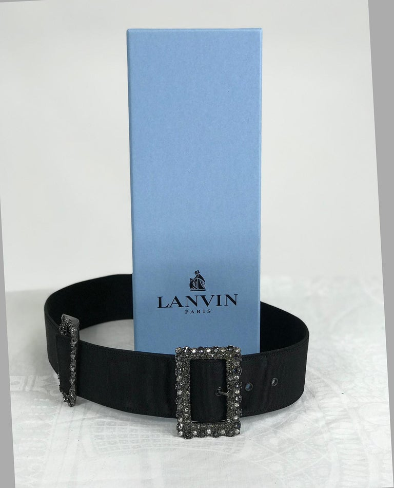 Lanvin crystal rhinestone buckle belt of wide black grosgrain, the buckle and keeper are set with smoke and crystal rhinestones. This beautifully designed and made belt is perfect for any time you want to show off your tiny waist, it's marked size