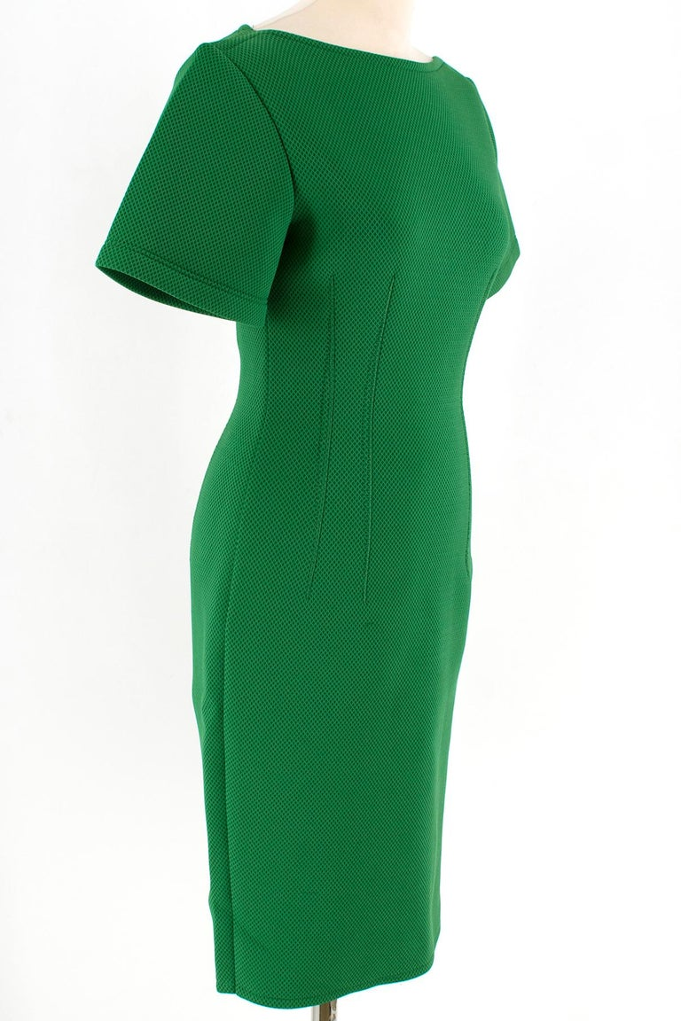 Lanvin Green Fitted Mesh Dress  Short sleeved mid-length green dress with stitch detailing  Stretch material Dart Stitch Detailing on dress front and back  Single back closure top to bottom of the dress Back dress slit   Please note, these items are