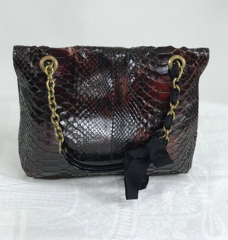 Lanvin Happy shoulder bag, red python with black faille trims and textured gold chain,black patent leather shoulder strap handles, black Lucite turn lock and plate with gold hardware. This beautiful bag is in very good pre owned condition.  The bag