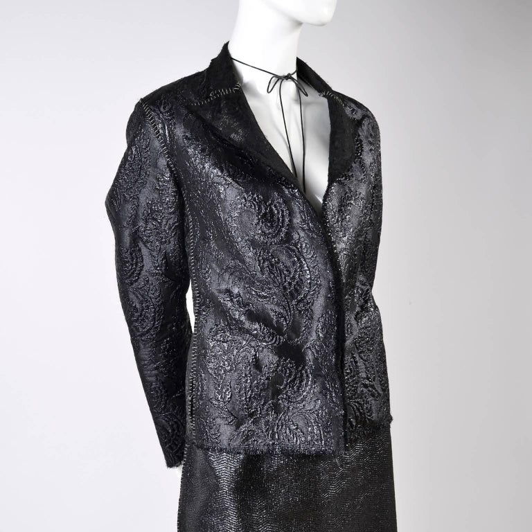 This is an exceptional Lanvin skirt suit designed by Alber Elbaz for the Spring Summer 2003 collection. The metallic acetate and Polymetal black two piece skirt suit is in a jacquard raised print . The jacket is labeled a size 40 and is open in the