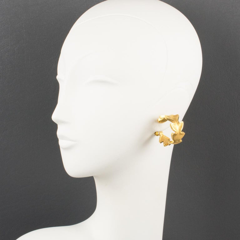 Superb Lanvin Paris gilt clip-on earrings. Large hoop shape with gilt metal all textured and matte finish aspect, featuring carved stylized leaves. Gilded tag underside marked: Lanvin - Paris.  Measurements: 0.63 in. wide (1.5 cm) x 1.25 in. deep