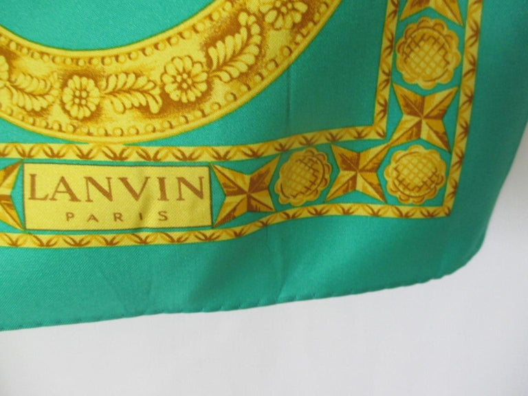 This vintage Lanvin scarf is a true collector's silk scarf in collector's condition, one to own to wear, show or frame.  The perfect colorway to accessorize your spring and summer wardrobes.  Made in Italy.  Excellent condition with a tiny spot, see