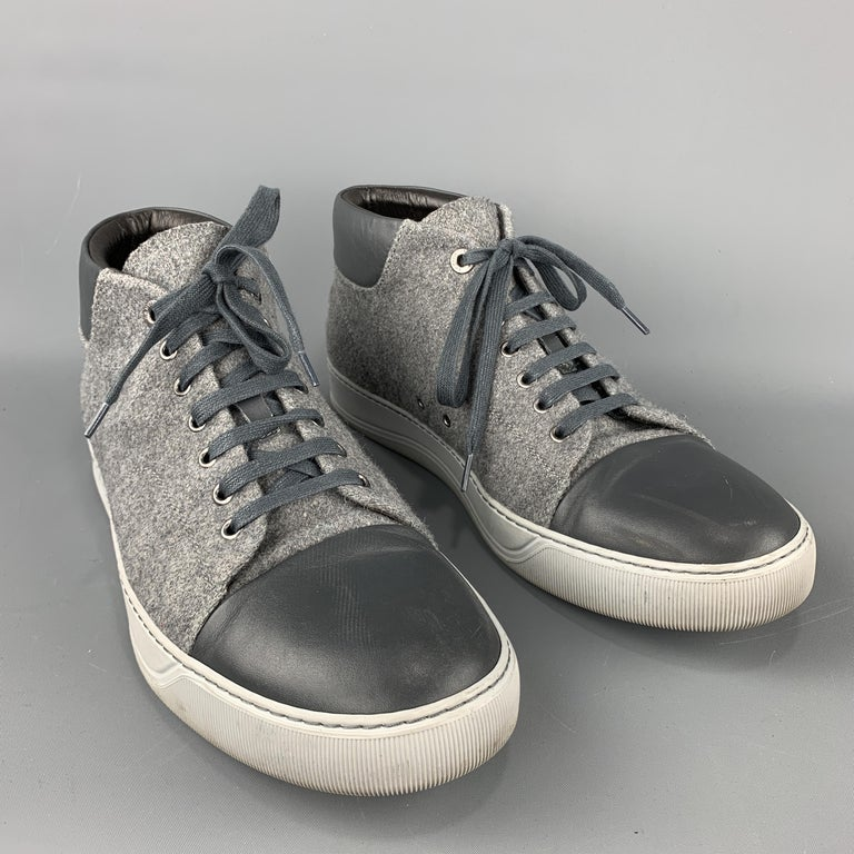 LANVIN Sneakers comes in grey tones in a solid wool material, with a leather trim, a high top, a cap toe, a rubber sole, lace up. Minor wear. Made in Portugal.  Very Good Pre-Owned Condition. Marked: 10  Outsole: 4.5 x 12.5 in.