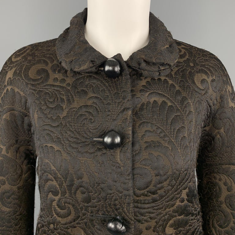 LANVIN Fall 2006 cropped jacket comes in brown and black textured brocade fabric with a Peter Pan collar and stuffed black leather buttons. Wear throughout fabric. Made in France.  Good Pre-Owned Condition. Marked: FR 36  Measurements:  Shoulder: 16