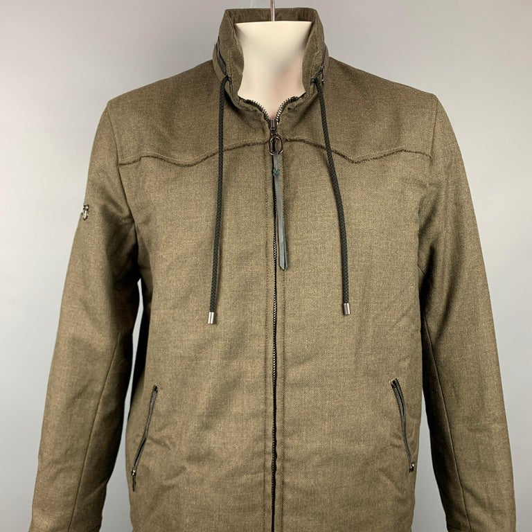 LANVIN jacket comes in a olive wool with a full liner featuring a adjustable hooded design, strap details, high collar, drawstring, ad a full zip up closure. Made in Romania.  Very Good Pre-Owned Condition. Marked: EU 52  Measurements:  Shoulder:
