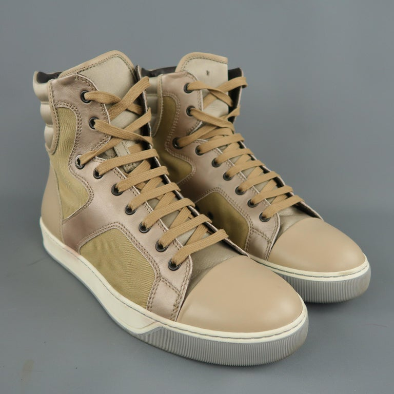 LANVIN high top sneakers come in gold canvas with a beige leather toe cap and heel, satin tongue, muted rose pink metallic leather trim, and quilted satin ankle panel. Made in Italy.   Good Pre-Owned Condition. Marked: UK 7   Measurements:   Length: