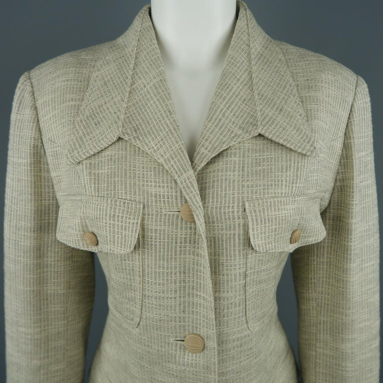 Vintage LANVIN jacket comes in a beige textured fabric with a downward point collar, three button, single breasted front, patch flap military pockets, and beige textured buttons.   Excellent Pre-Owned Condition. Marked: FR 40   Measurements: