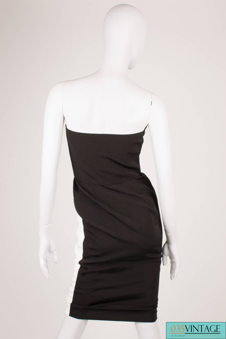 Beautiful 80's vintage dress by Lanvin in black and white, adorable!  This strapless dress has front zip closure which is hidden underneath the white part whit the black buttons. You have to unloose these buttons, before you can put it on. Very