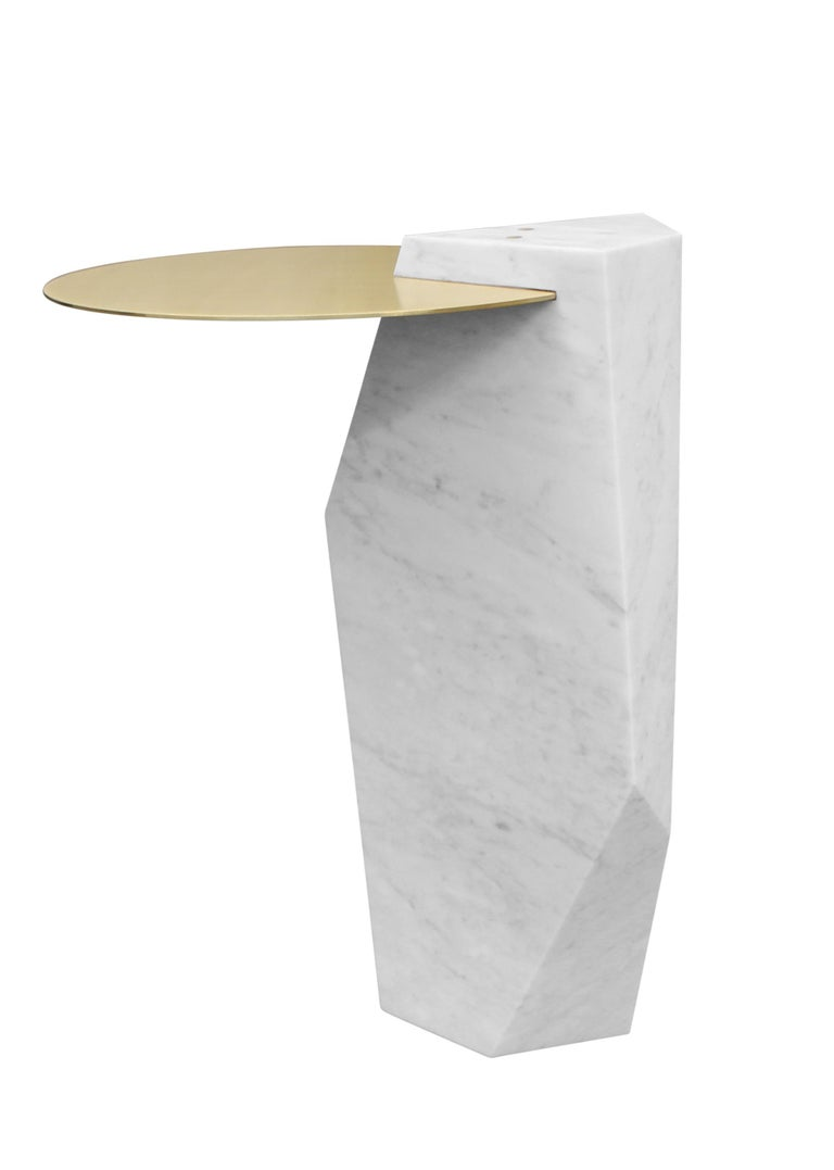 A solid block of Italian Carrara marble, carved and inset with a brass tray. Available in a variety of colored marbles and numerous metal options. Can also be made as a dining or console table.
