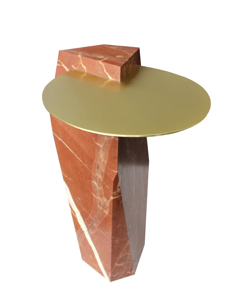 A solid block of Rosso Collemandina marble, quarried in Tuscany, carved and inset with brass tray. Available in a variety of colored marbles and numerous metal options. Can also be made as a dining or console table.