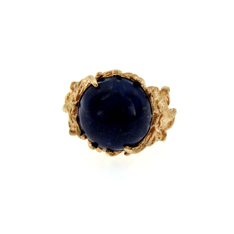Unique and pleasant unisex Ring mounted in 18k Rose Gold. The Ring features a dragon sculpture at two sides and a sparkling and large blu lapis.   CONDITION: Brand New METAL: 18k Rose Gold  GEM STONE: Lapis DESIGN ERA: Contemporary WEIGHT: 17.45