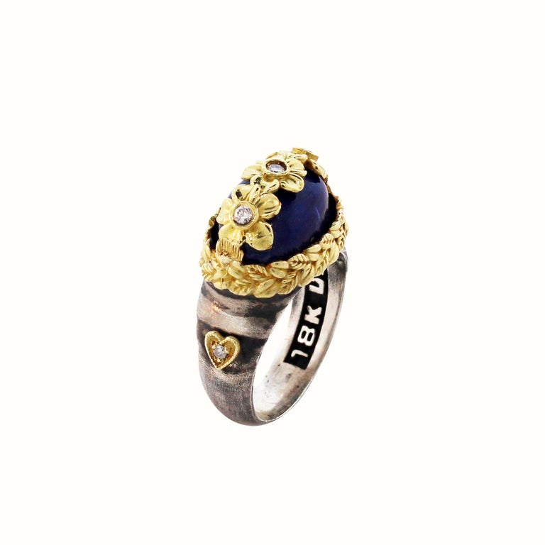 Aged Silver & 18K Gold Floral Ring with Diamonds and Lapis Lazuli Center by Stambolian  Center is oval Lapis Lazuli with floral diamond design work set right above  0.11 carat diamonds  Lapis Lazuli is apprx. 8 carat  Ring face is 0.7 inch x 0.4