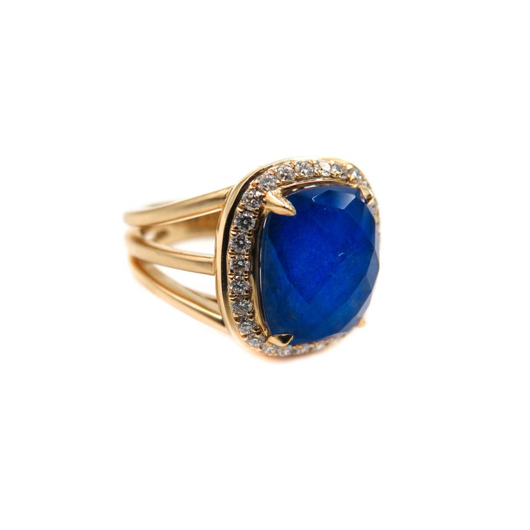 Royalty meets fashion. A deep intense blue with golden inclusions that shimmer likes stars in a night sky. This gorgeous Lapis and Diamond Ring is the result of overlapping a beautiful faceted clear quartz over a deep blue lapis lazuli, creating