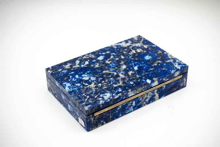Beautiful Sodalite box with hinged lid. Sodalite is a rich royal blue tectosilicate mineral widely used as an ornamental gemstone.  Sodalite is believed to encourage rational thought, objectivity, truth and intuition, along with verbalisation of