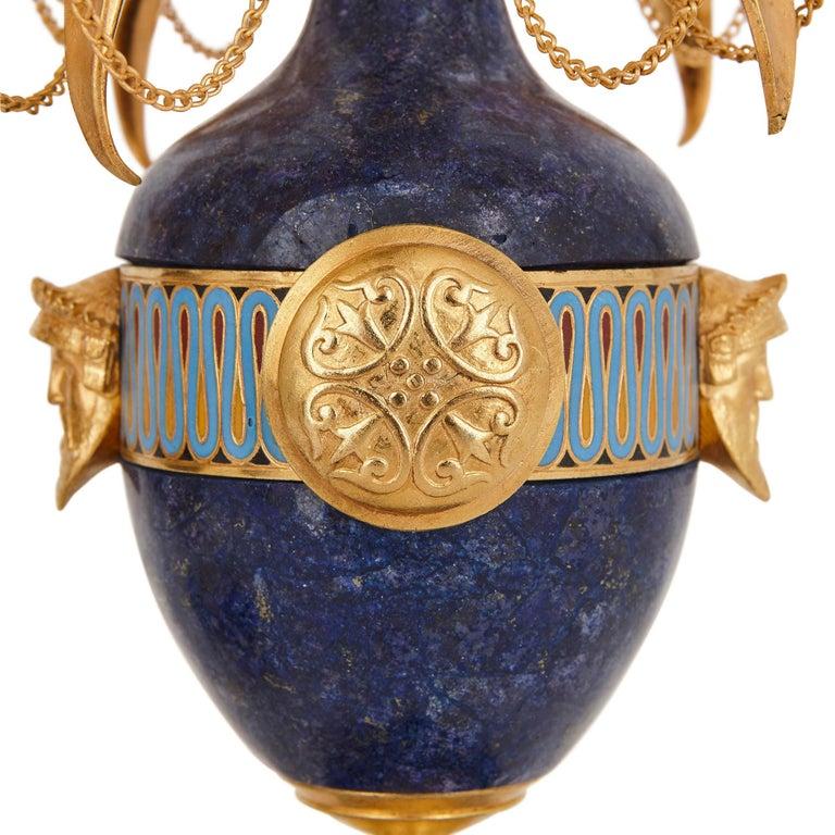 Enamel Lapis, enamel, and gilt bronze clock garniture For Sale