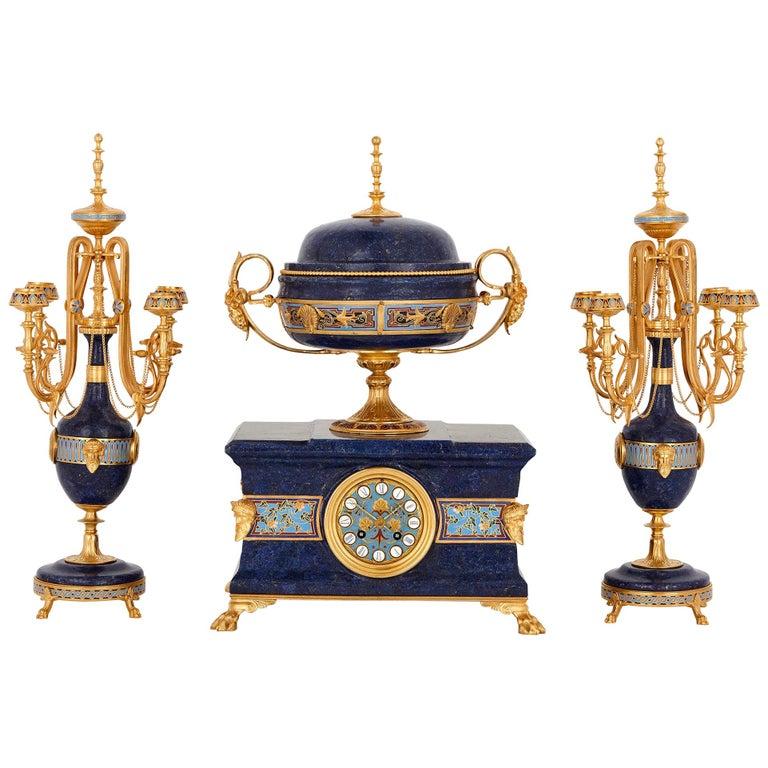 Lapis, enamel, and gilt bronze clock garniture For Sale