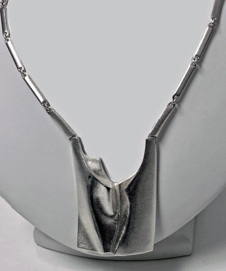 Lapponia Sterling Necklace Finland 1994, designed by Björn Weckström for Lapponia. Rectangular abstract modernism design, together with knife edge and loop chain. Full marks. Length approximately 32 inches. Drop 3 inches. Item weight approximately