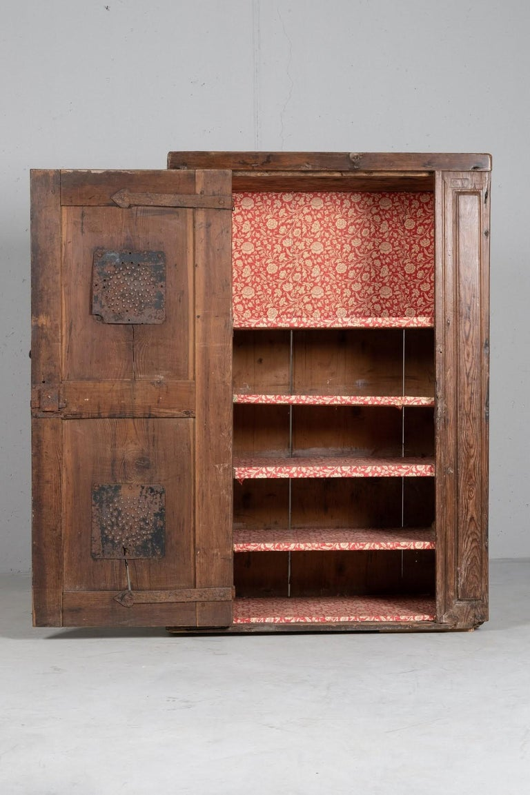 Originally built in the wall, this unique cupboard maintains an extraordinary patina, that recorded wonderfully over 400 years of history.