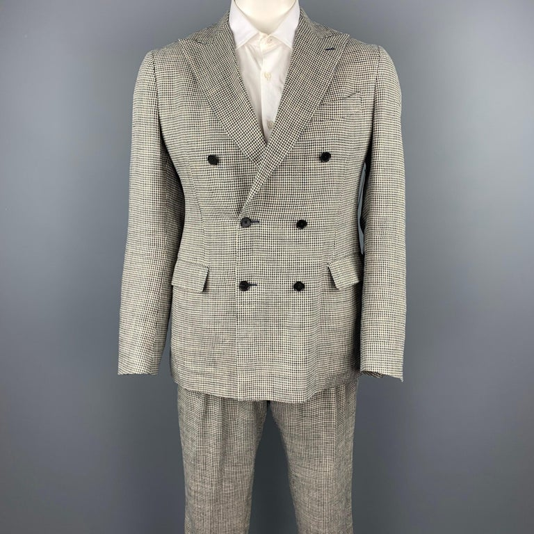 LARDINI suit comes in black & beige houndstooth silk / linen with a full liner and includes a double breasted,  button sport coat with a peak lapel and matching pleated front trousers. Made in Italy.  Very Good Pre-Owned Condition. Marked: IT 52 R
