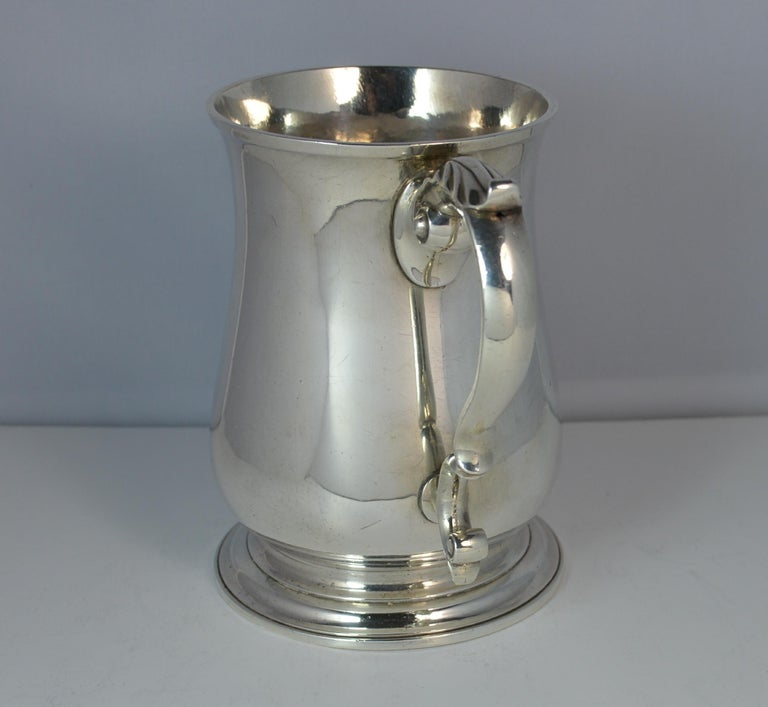 A quality sterling silver early Georgian tankard.  Well made and substantial example, good gauge of silver. English made piece with fine handle and plain finish through. All as originally made, no additional Victorian engraving as with the majority