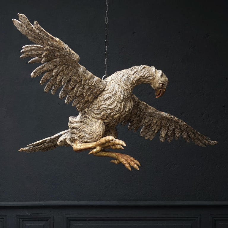 This is a very rare large antique hand carved, polychromed and gilt eagle. Unbelievable workmanship went into making this wooden bird of prey sculpture with spread wings.   Maybe it used to be part of a larger presentation, probably in a church,