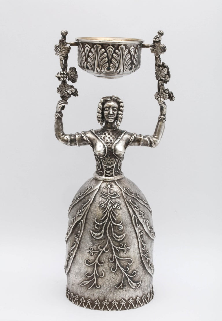 Large, 17th Century-Style sterling silver wager/marriage cup, Spain, circa 1950s, Damian Garrido - maker. Measures 9 3/4 inches high x almost 3 1/2 inches diameter across bottom of woman's skirt. Upper cup, which swivels on handles held up by the