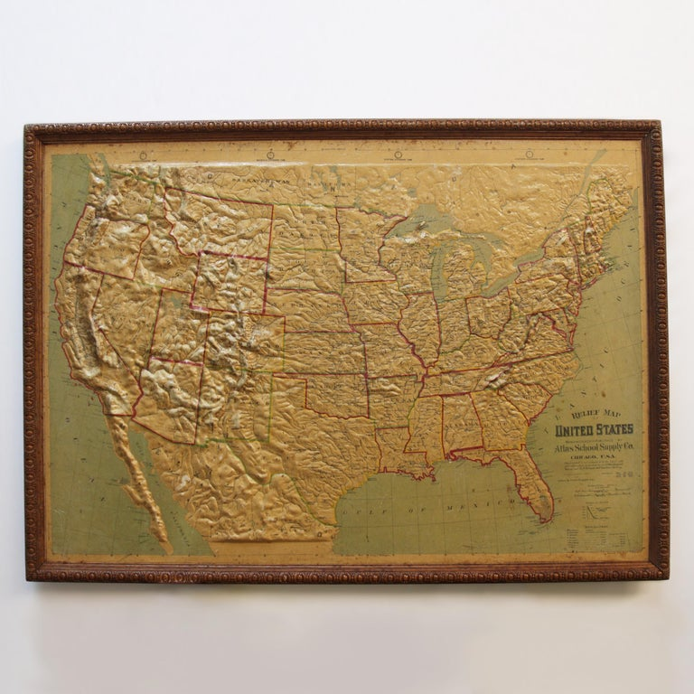 Remarkably original, 1907 Relief map of the United States by the Atlas School Supply Co. of Chicago, Illinois. This exceptional quality map features its original oak frame, heavy-duty stretcher, bold graphics and beautifully molded 3-D Papier-mâché