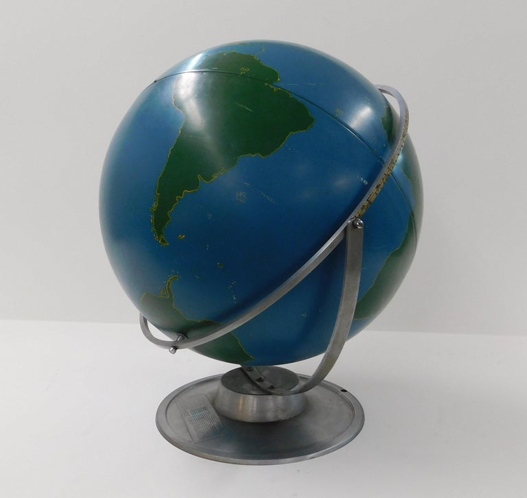 Large lacquer over aluminum rotating and swivel aviation military training globe on an aluminum base, strong steel construction circa 1940 manufactured in Chicago Illinois. These were designed to be written on with chalk to depict and train for