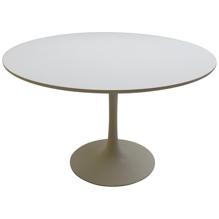 A large 1960s tulip dining table designed by Maurice Burke and manufactured by Arkana, Bath, UK.  The base is made from cast Aluminium and is painted white, the top is made from white Formica.   In good vintage condition, with minimal signs of