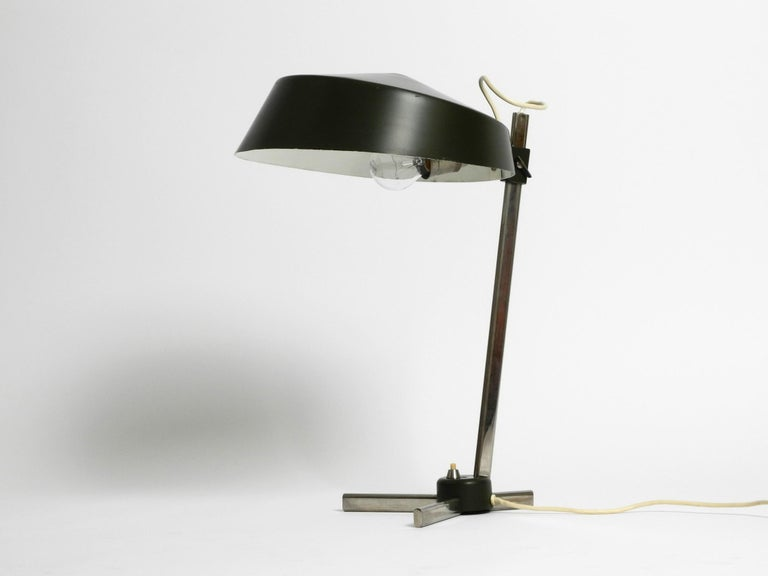 High quality 1960s Industrial table lamp with height-adjustable shade.  Great rare Industrial Design. Made in Germany. The shade is steplessly adjustable in height and holds firmly in any position. Shade and foot are covered with the original