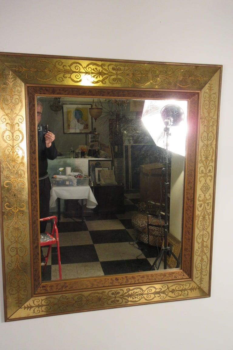Large 1960s Italian églomisé mirror. Hand painted and gilded.
