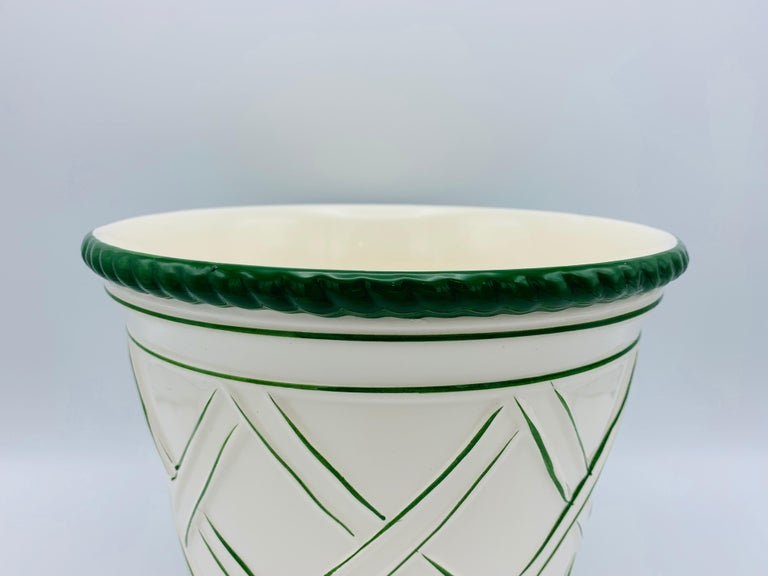 Listed is a fabulous and large, 1960s Italian ceramic cachepot planter. The piece is primarily white with Kelly green lattice work all-over and ridged upper and lower collars. Heavy, weighing 3.7lbs.