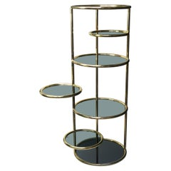 Large 1960s Milo Baughman Style Seven Tiered Brass Smoked Glass Swivel Étagère