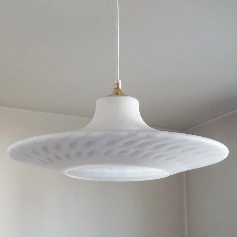 A rare large Murano glass flush mount or pendant by Peill & Putzler, Germany, 1960-1969. Elegant design in the manner of Stilnovo, white glass with beautiful inclusions, impressive light effects. Brass-mounted, original manufacturer's labels,