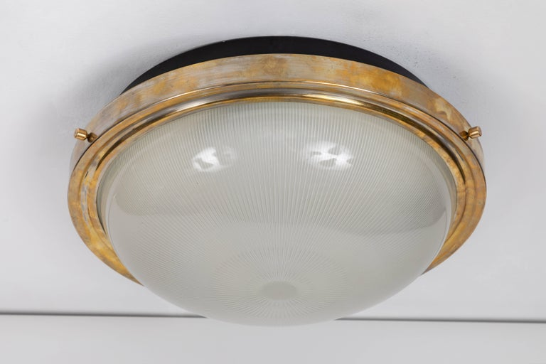Large Sergio Mazza wall or ceiling light for Artemide, circa 1960s. This architectural and Minimalist designed light an be used as a flush mount or sconce. Executed in black metal, brass and pressed glass.