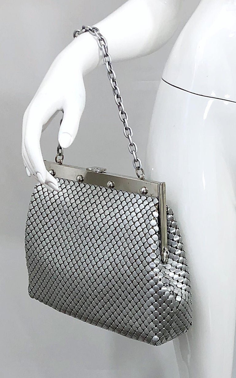 Chic and rare large silver / nickel 1960s WHITING AND DAVIS chain mail metal bag! Features clasp closure and chain strap. Light rayon interior makes it easy to find items. One single pocket. Can be worn either as a handbag or shoulder bag. Fits all