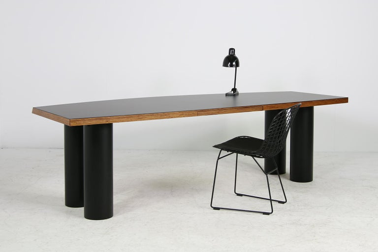 Beautiful and unique 1970s architect's design writing table, made of heavy weight solid plywood, the columns are made of hard polyvinyl, very sturdy material, the desk surface is covered with black matte formica, under this a light wooden structure