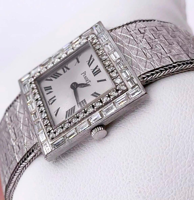 Contemporary Large 1970s Piaget 18kt Double Diamond Row Roman Numeral Textured Bracelet Watch For Sale