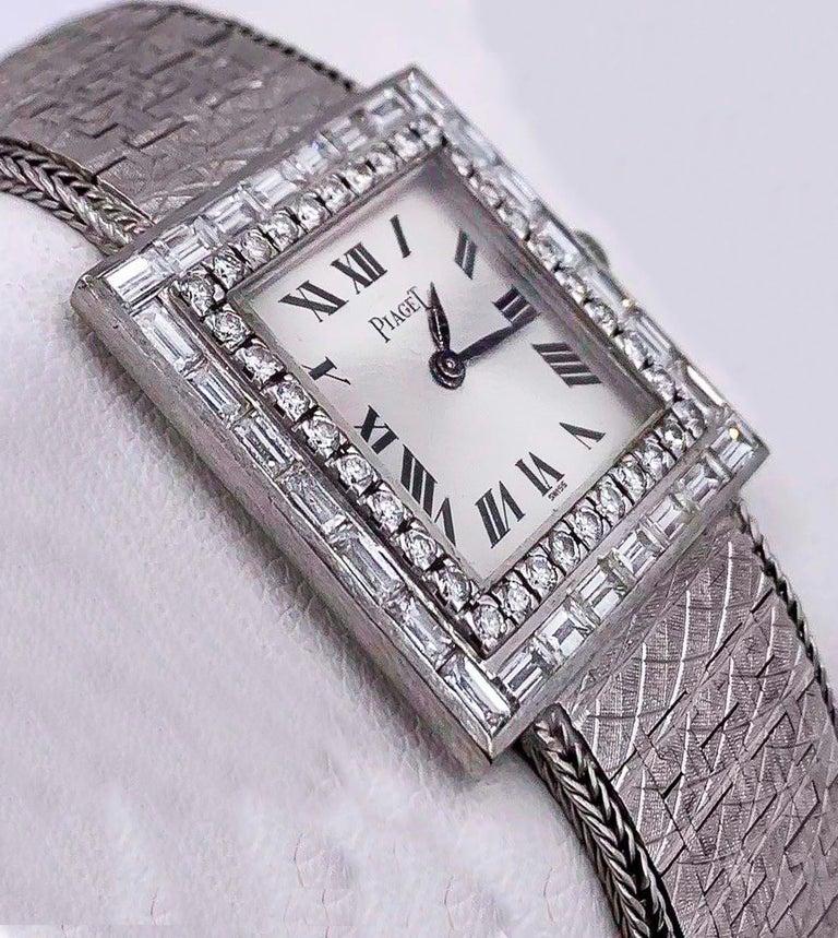 Baguette Cut Large 1970s Piaget 18kt Double Diamond Row Roman Numeral Textured Bracelet Watch For Sale