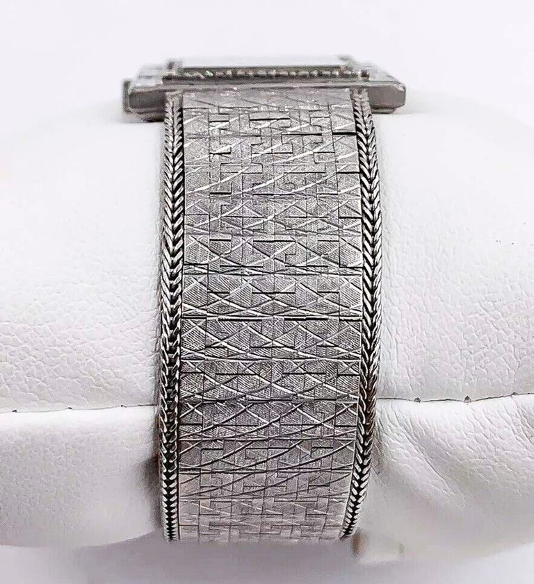 Women's or Men's Large 1970s Piaget 18kt Double Diamond Row Roman Numeral Textured Bracelet Watch For Sale
