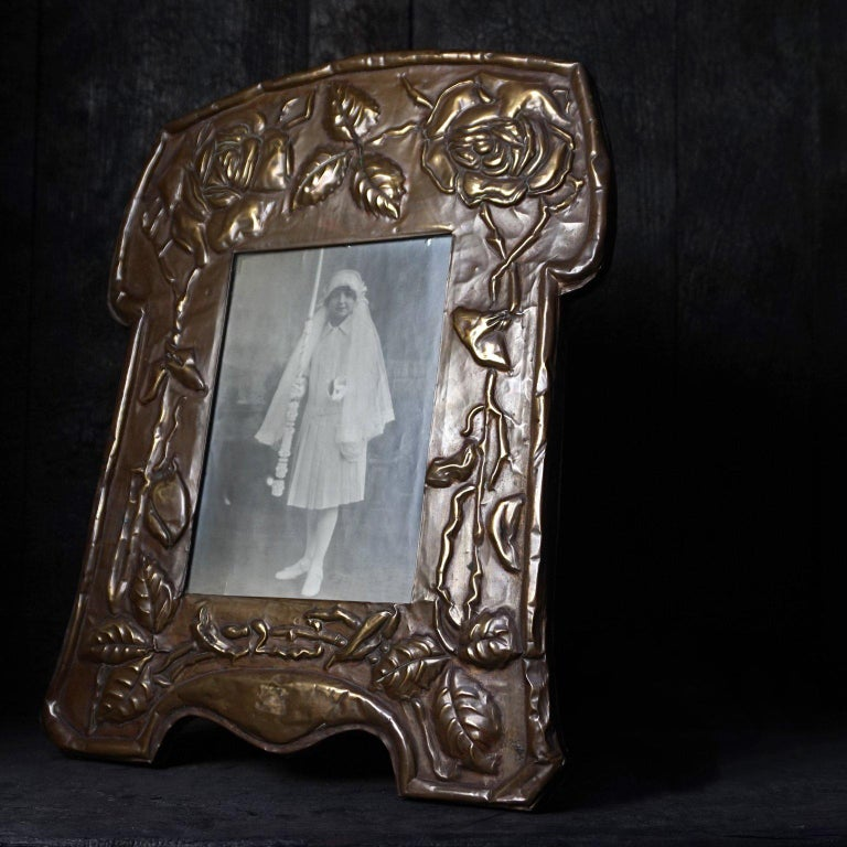 Hammered Large 19th Century Art Nouveau Latten Picture Frame Decorated with Roses For Sale