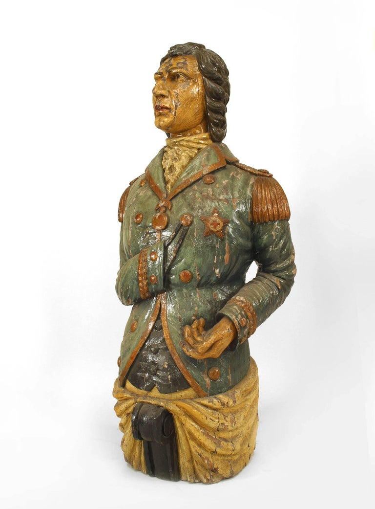 Nineteenth century English largescale figurehead composed of wood carved and painted in the likeness of a veteran Lord Nelson clothed in military regalia.