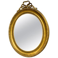 Large 19th Century French Gilt Oval Mirror with Original Bevelled Mirror Plate
