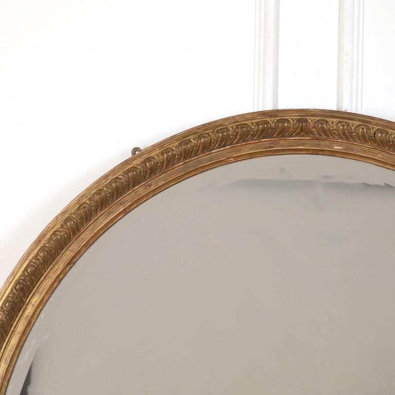 19th century English gilded oval mirror, circa 1860.