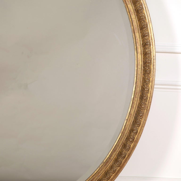 English Large 19th Century Gilded Oval Mirror For Sale