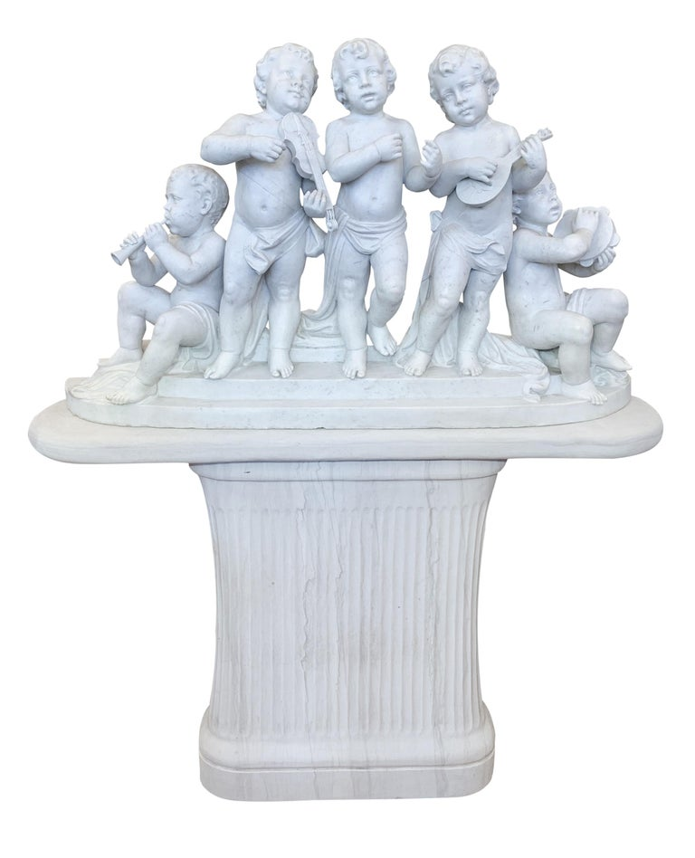 A large and finely carved 19th century Italian white marble musical group. This lovely group depicting five Bacchic putti musicians playing various musical instruments. Four of them playing trumpet, mandolin, tambourine, violin and one singer. Three