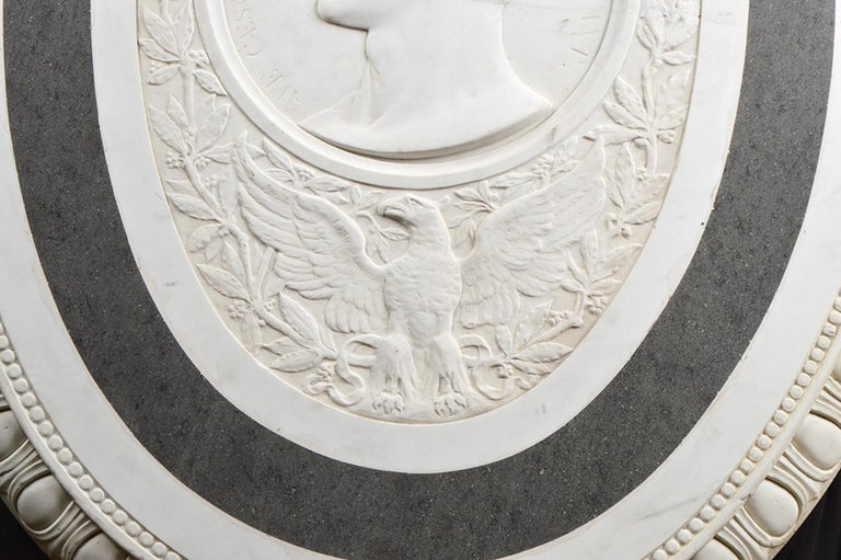 45 inches high and 34.5 inches wide this truly is an impressive manifestation of 19th century Italian carving craftsmanship. The relief is centering a circular profile portrait of the emperor Claudius, who ruled Rome from 41-54, surrounded by a