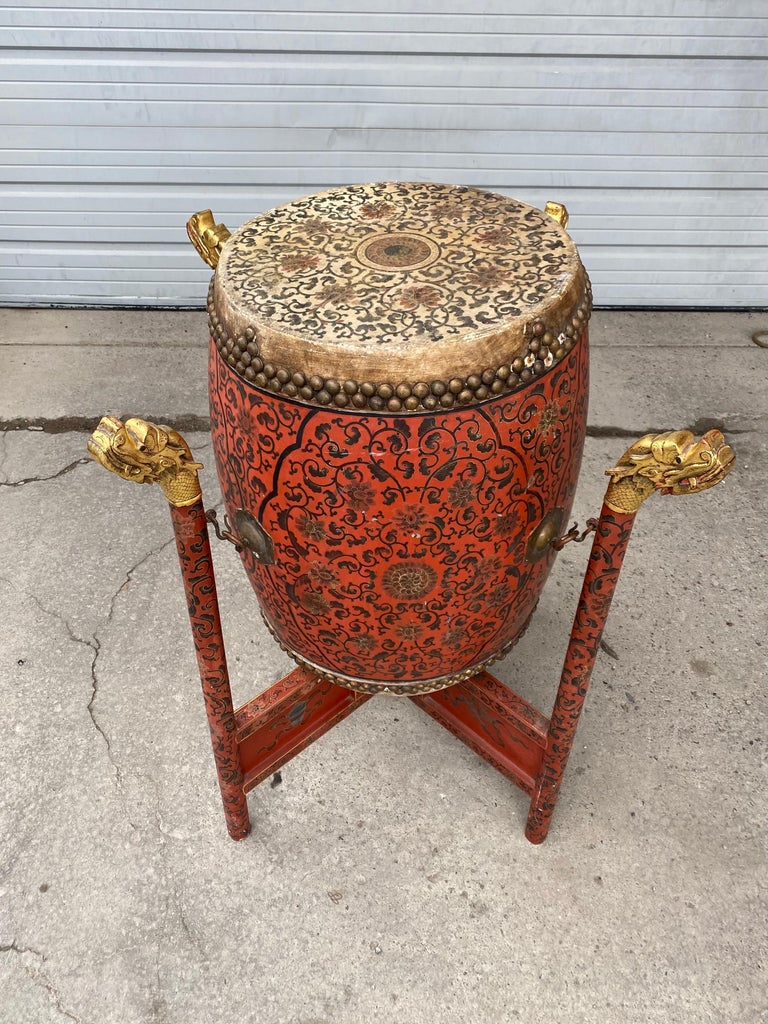 Large 19th century Qing Dynasty Chinese ceremonial lacquered drum, highly decorated, painted, gold gilded dragon head stand, hand decorated top and bottom animal skin, drum measures 22