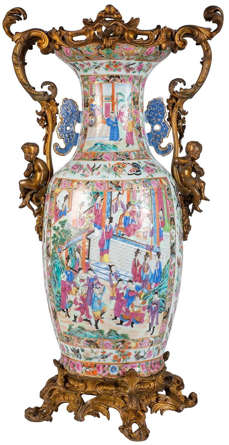 A very impressive 19th century Chinese rose medallion / canton vase / lamp, having wonderful gilded ormolu scrolling foliate Rococo style mounts with putti seated on either side. The vase having beautifully hand painted inset panels depicting