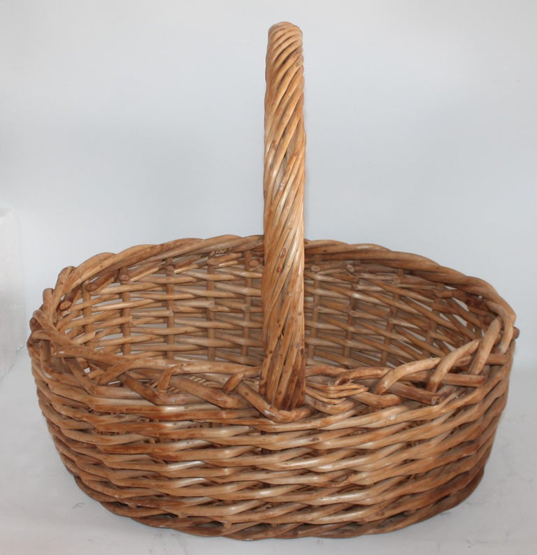 This large rustic basket was found in the mid west and is in fine condition. It is unfinished or natural finish. The condition is very good.